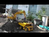 热点 金属液压!遥控挖掘机与大型自卸车视频表